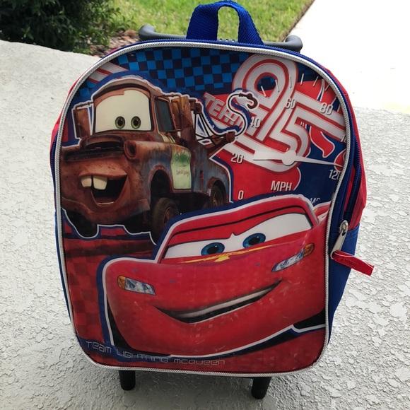 35860ae1624 Disney Other - Cars Lightning McQueen Wheeled Backpack NWOT